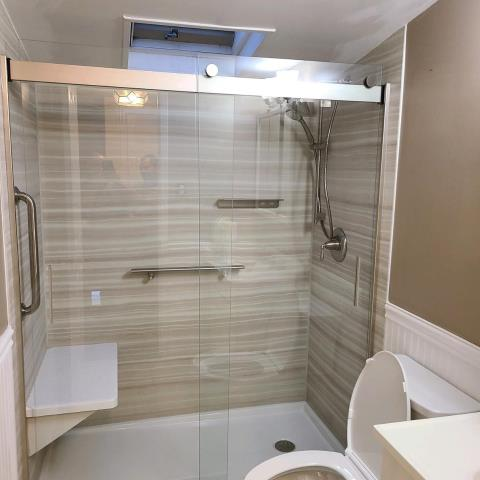 Massapequa, NY - Why risk it and try to balance yourself in the shower when you can have a seat in your new Kohler Luxstone shower system! Great Job with this beautiful one-day bathroom remodel!