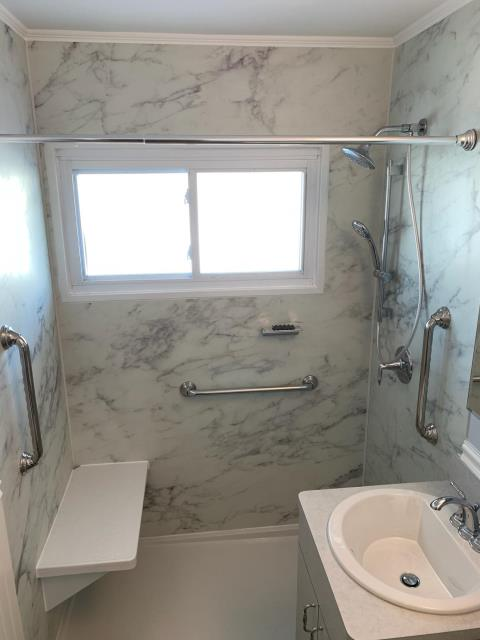 Levittown, NY - Converting your tub to a shower with a seat has tons of benefits for people of all ages! The Calacatta Crema walls Luxstone Shower walls are so nice! Great job guys! Thank you to the Scibilia family! KOHLER Direct Advantage Magazine #kohlerluxstoneshower #bathroomdesign #designinspiration #luxury #elitequality #homedecor