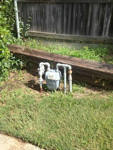 Carrollton, TX - Giving an estimate for repairing a gas system.