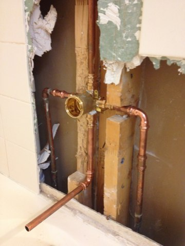 Coppell, TX - Installing a new Delta tub valve in the upstairs master bath. Tile repair is included.