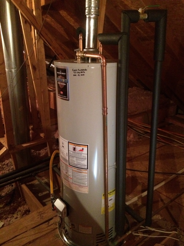 Installing new Bradford White 50 gallon natural gas water heater. Installation is in attic above garage. To limit flood damage, we installed a WAGS automatic water shutoff valve. This package comes with a 10 year parts and labor warranty.