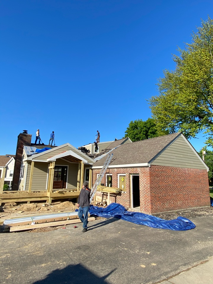 Cincinnati, OH - New shingles going on this home today in Montgomery as well as new siding soffit and fascia.