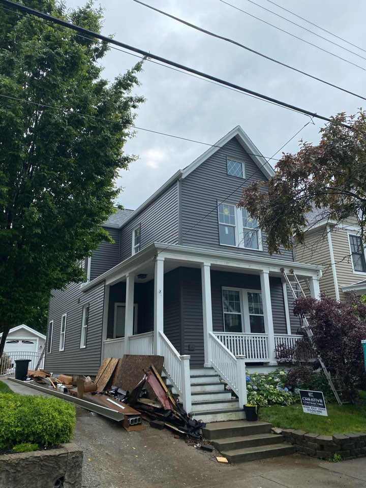 """Cincinnati, OH - Sterling Exteriors replacing old rotted siding soffit and trim woth new vinyl siding and soffits aluminum fascia and 6"""" seamless gutters."""