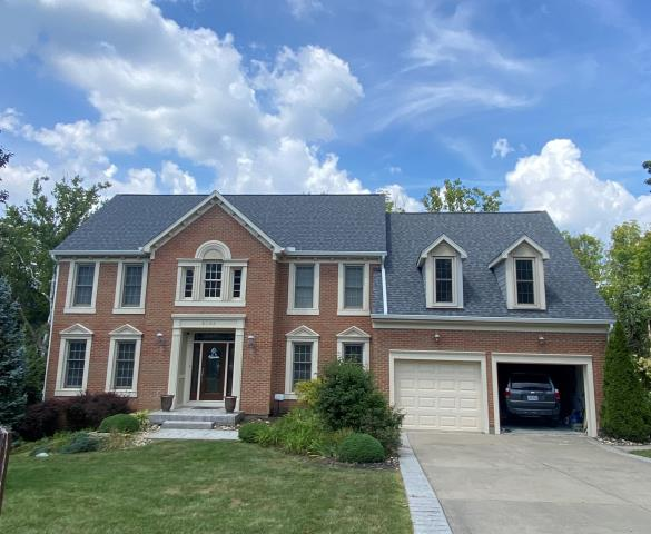 West Chester Township, OH - Sterling put  a new shingle roof, new siding and gutters on this lovely brick home in West Chester.