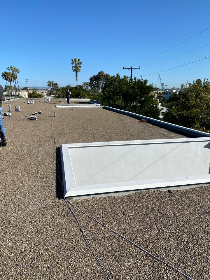 San Diego, CA - Re roofing job walk new TPO 60 mil