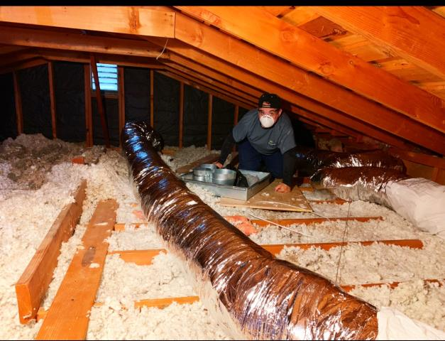 San Diego, CA - Working in the attic in Scripps Ranch.