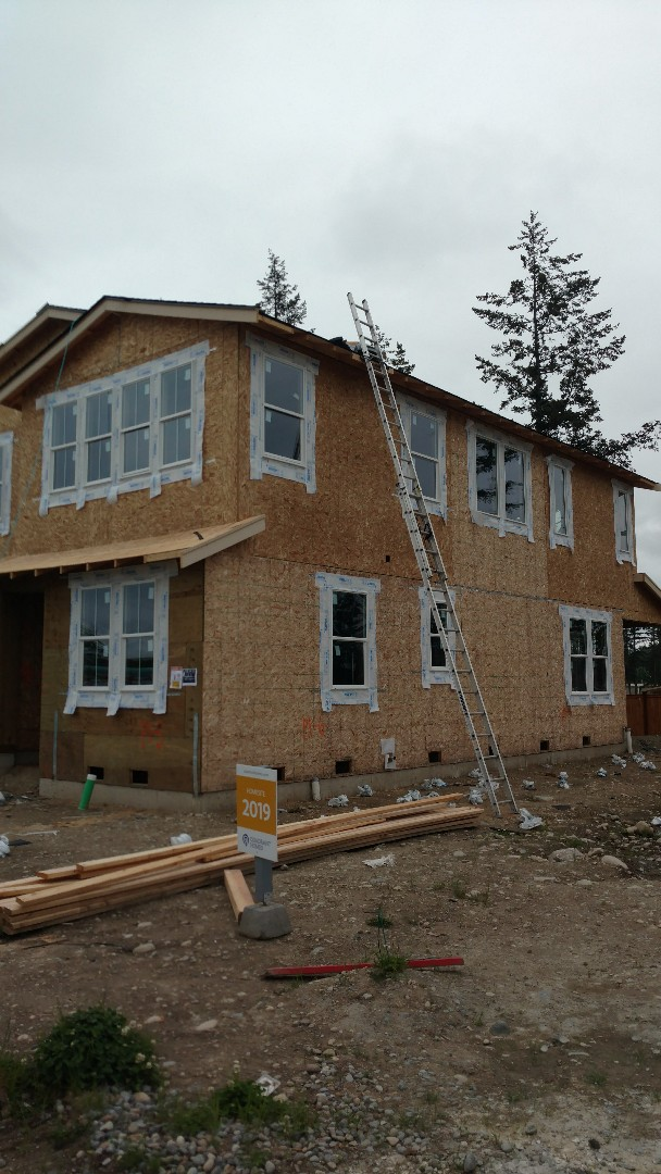 Maple Valley, WA - Installing IKO Cambridge dual black shingles on a current project by Quadrant Homes.