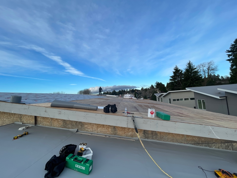 Renton, WA - Firestone 60 mil TPO in grey on new construction commercial roof in Renton