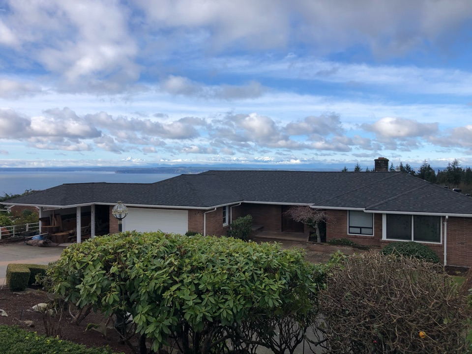 Shoreline, WA - Completed re-roof with tear off of old cedar shake shingles, full re-sheet, and installation of IKO Cambridge AR roofing shingle in dual black.