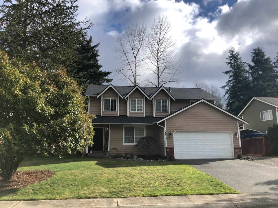 Puyallup, WA - Completed re-roof with tear off of old roofing shingles and replaced with IKO Cambridge AR in dual black.
