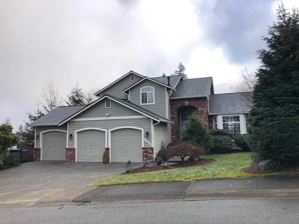 Everett, WA - Completed re-roof with tear off of old roof shingles and installation of GAF Timberline HDZ roof shingles in pewter gray. Also installed new gutter system and new skylight.