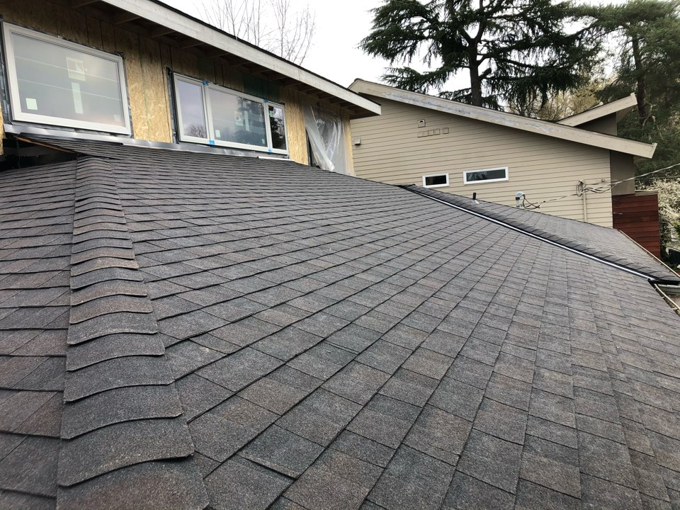 Seattle, WA - New roof needed on complete home remodel. Tear off of old roof and installation of Certainteed Landmark.