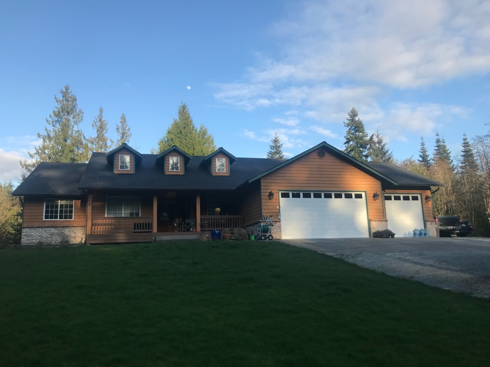 Stanwood, WA - Completed re-roof with tear off of old roofing and installation of GAF Timberline HDZ roofing shingles in charcoal gray.