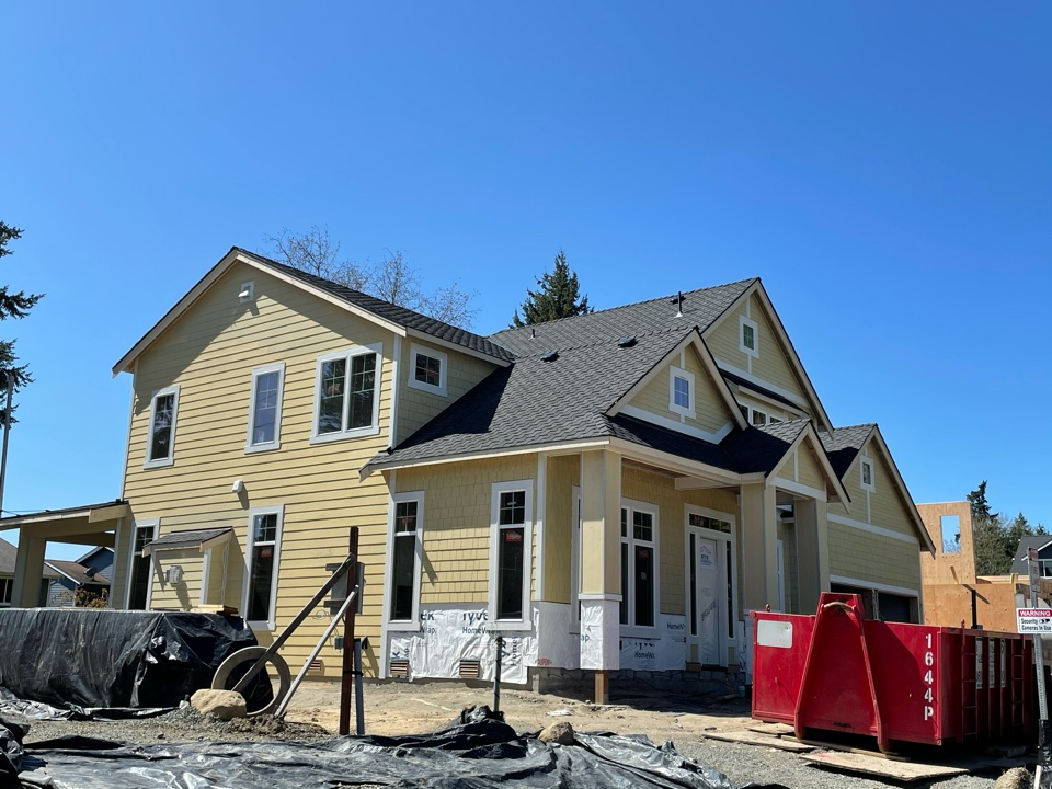 Woodinville, WA - New construction project with installation of the GAF Grand Sequoia roofing shingle in charcoal.