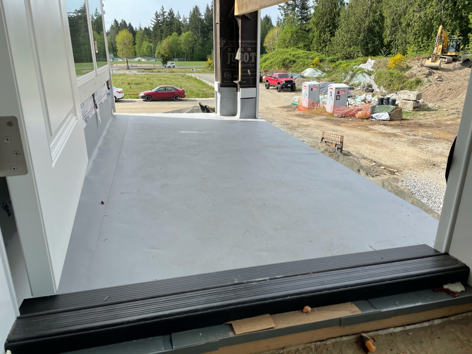 Bonney Lake, WA - New construction deck install of Firestone 60mil TPO in gray.