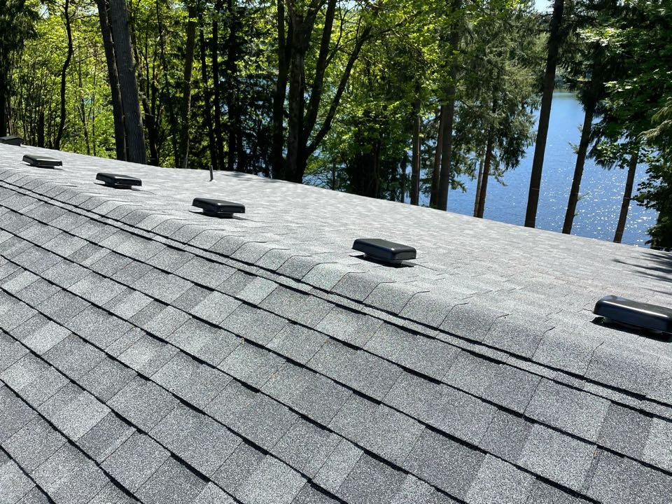 Snohomish, WA - Completed re-roof with full re-sheet, new fascia, and installation on IKO Cambridge AR in charcoal.