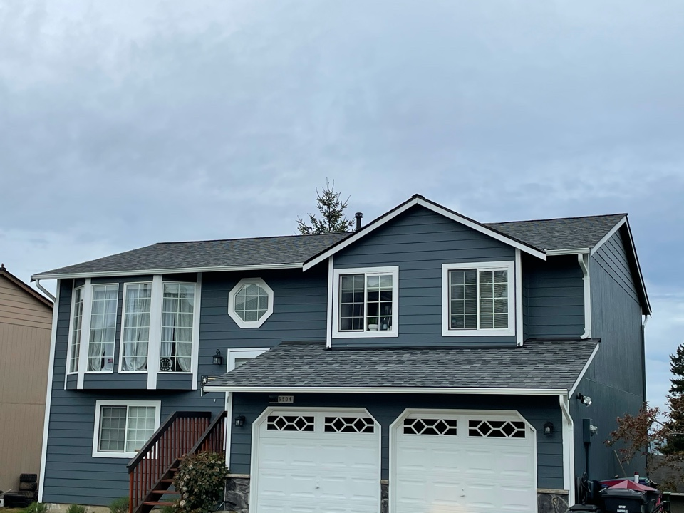 Marysville, WA - Completed re-roof with tear off of old roofing and installation of the IKO Cambridge AR roof shingle in charcoal.