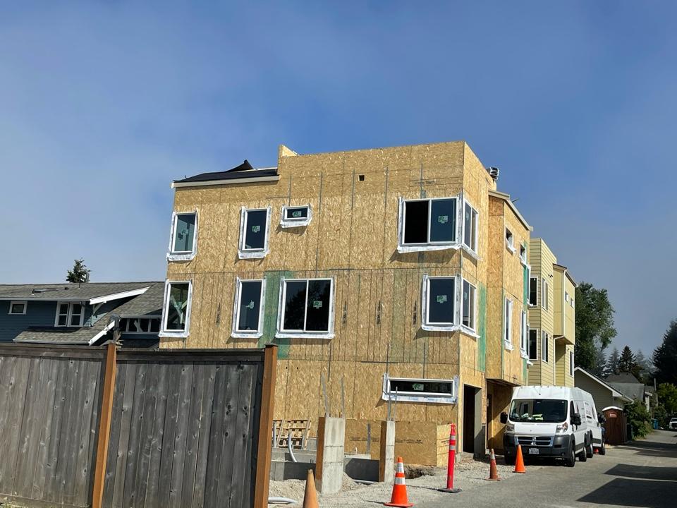 Seattle, WA - New construction installing iko shingle and Firestone tpo on flat roof
