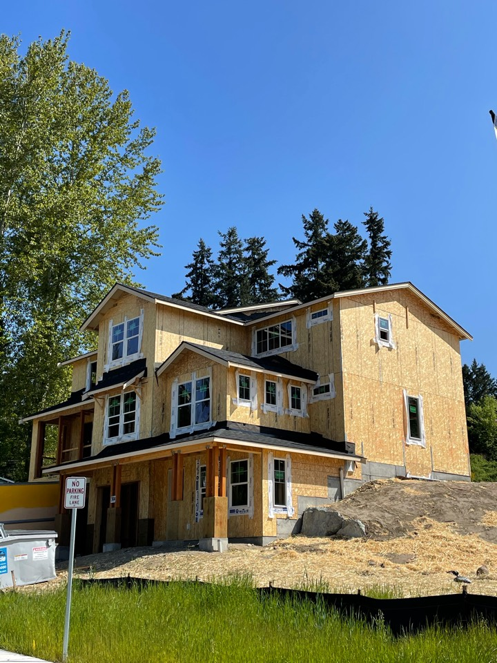 Bothell, WA - New construction roofing install of IKO Cambridge AR shingle in dual black.