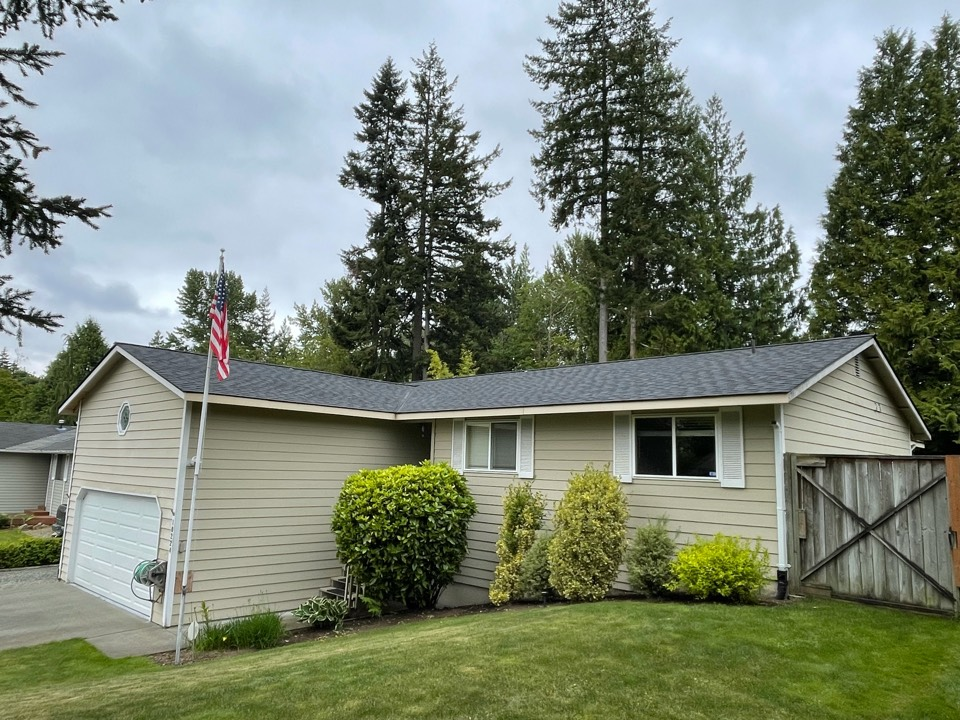 Everett, WA - Completed re-roof with tear off of two layers existing roofing, plywood replacement in the eaves, new gutters, and installation of IKO Cambridge AR in dual black.