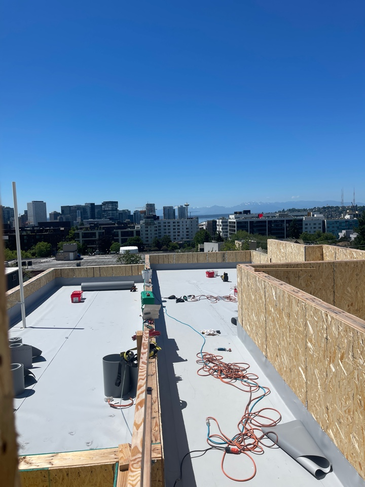 Seattle, WA - Installing iso and densdeck with 60 mil Firestone TPO