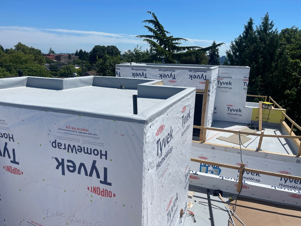 Seattle, WA - Installing iso insulation and 60 mil Grey TPO