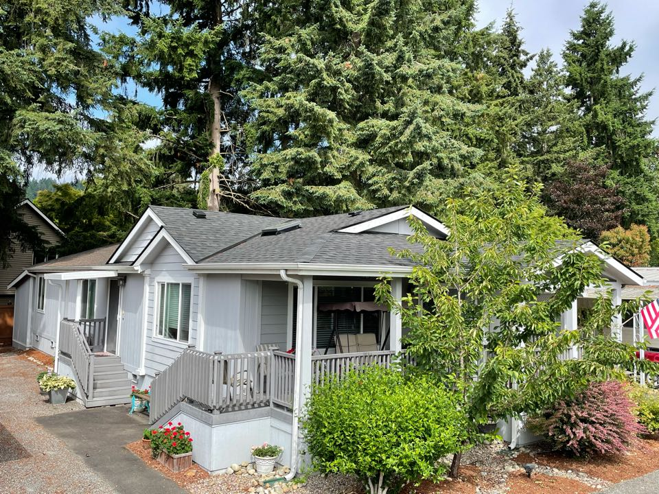 Redmond, WA - Completed re-roof with full tear off of old roofing system and installation of IKO Cambridge AR roofing shingle in charcoal.