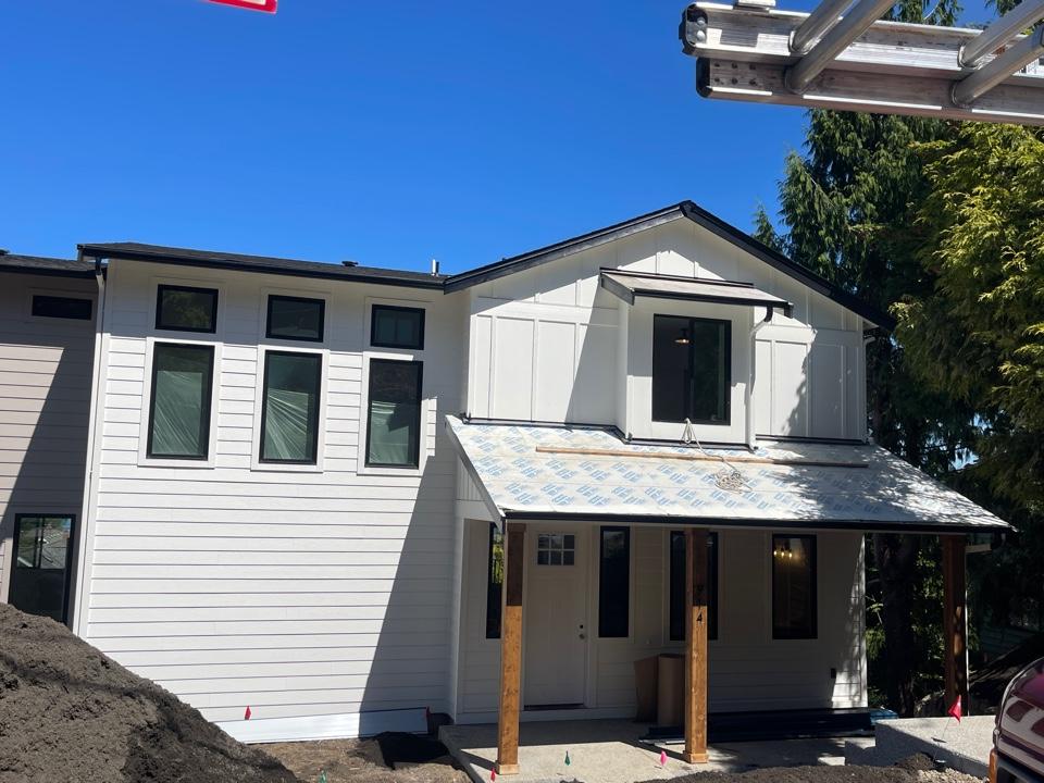 Mukilteo, WA - Installing Nu-Ray metal panels on shed roofs