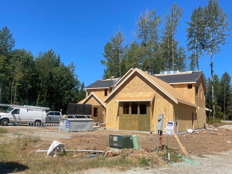 Monroe, WA - Installing new construction Iko dual black shingle