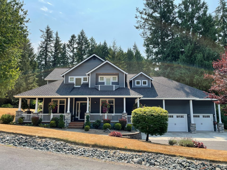 Redmond, WA - Completed re-roof with tear off of old roofing material and installation of the GAF Grand Sequoia roofing shingle in charcoal.