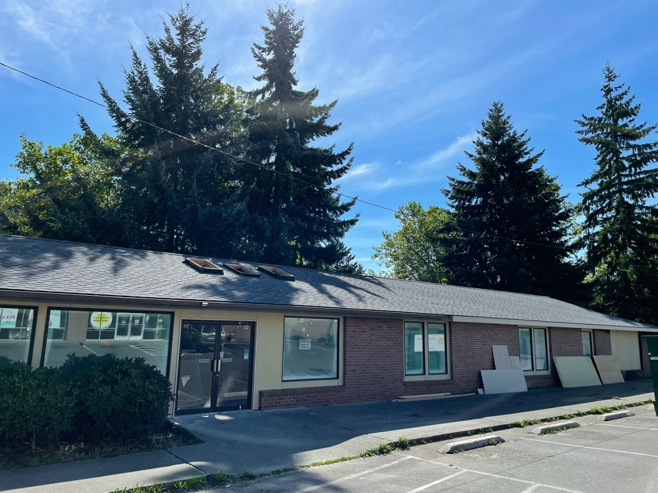 Everett, WA - Completed re-roof on a commercial building. Tear off of old roofing system and replaced with IKO Cambridge roofing shingle in charcoal.