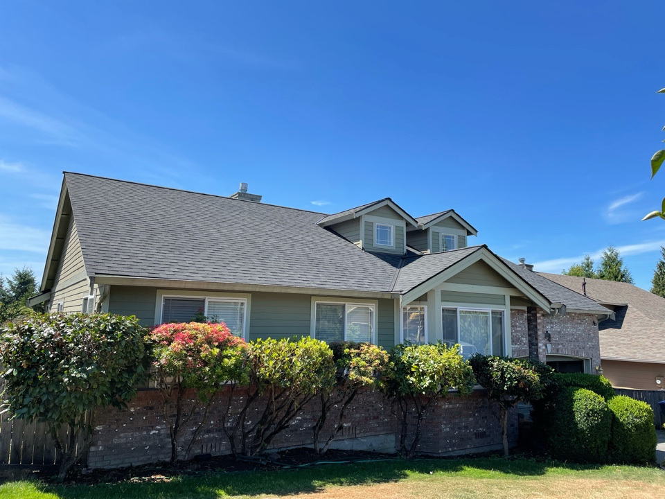 Maple Valley, WA - Completed re-roof with tear off of old roofing shingles and replaced with IKO Cambridge AR shingle in dual black.