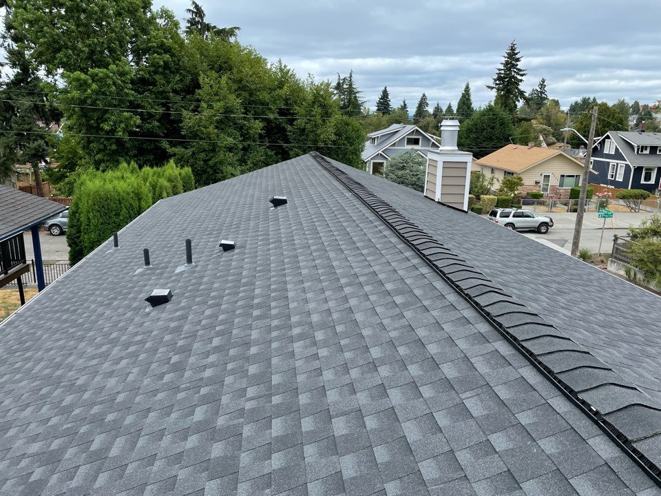 Seattle, WA - Completed re-roof with tear off of old roofing system and installation of GAF Timberline HDZ in charcoal.
