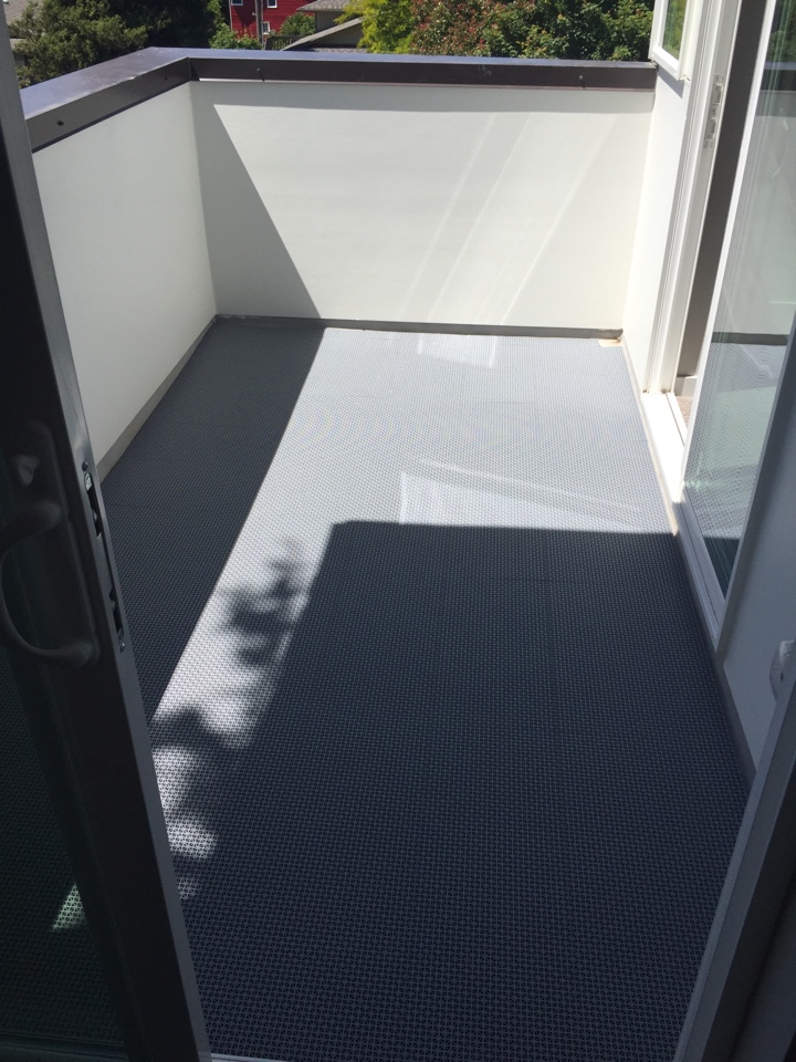 Seattle, WA - Walking deck tiles floated over TPO