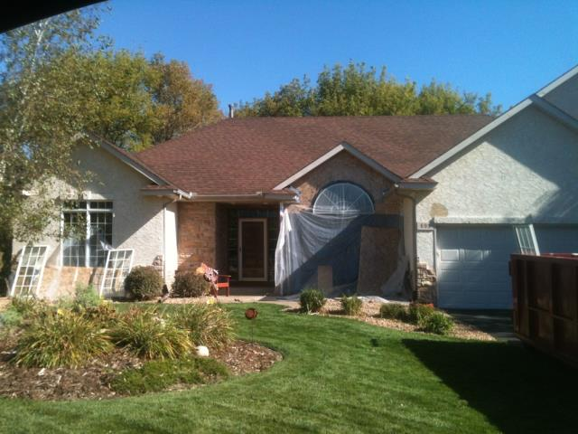 "Oakdale, MN - This is the ""before"" picture of a home in Oakdale before we installed James Hardie siding with Boral stone."