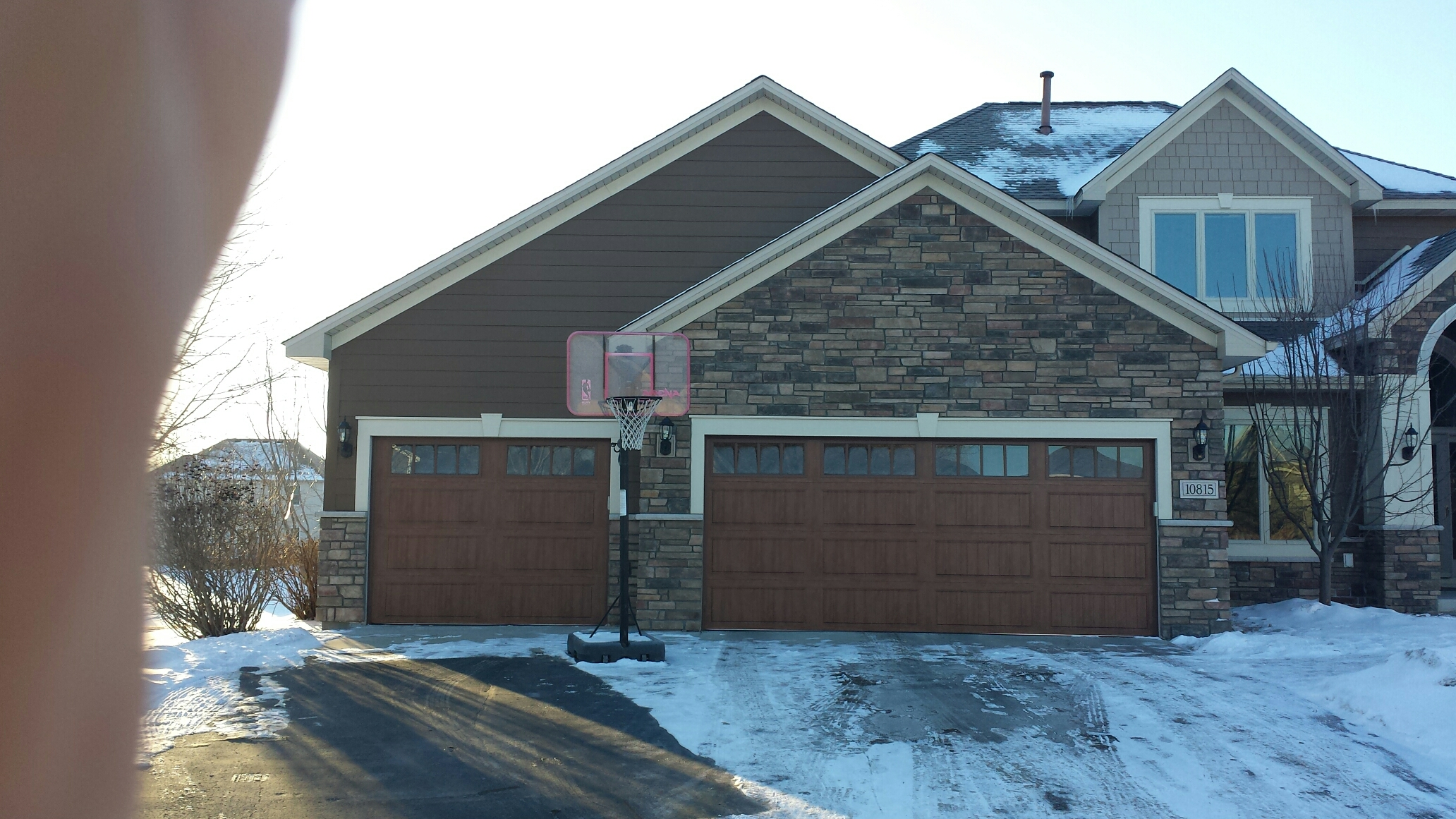 Minneapolis, MN -  Color plus james hardie siding. Boral stone. Clopay dark oak garage doors.