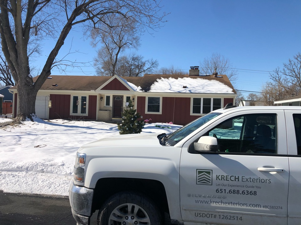 """Minneapolis, MN - On this house we did a complete overhaul.  For the siding we used LP SmartSide lap and board & batten in the color """"redwood"""". For the trim we used LP Smart side in the color sand dunes. We also installed new soffit, fascia and gutters in the color almond. This house looks great!!"""
