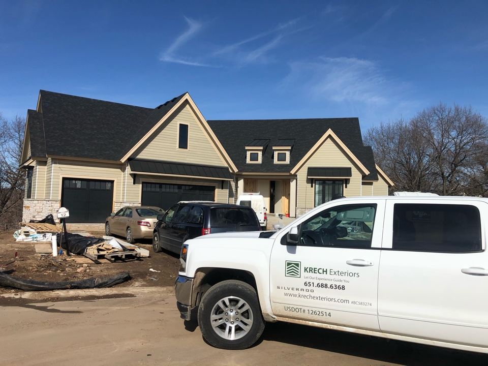Eden Prairie, MN - On this custom built house we installed James Hardie lap siding, soffit and fascia. All material is primed and ready for paint. This house also features detailed trim work that looks amazing.