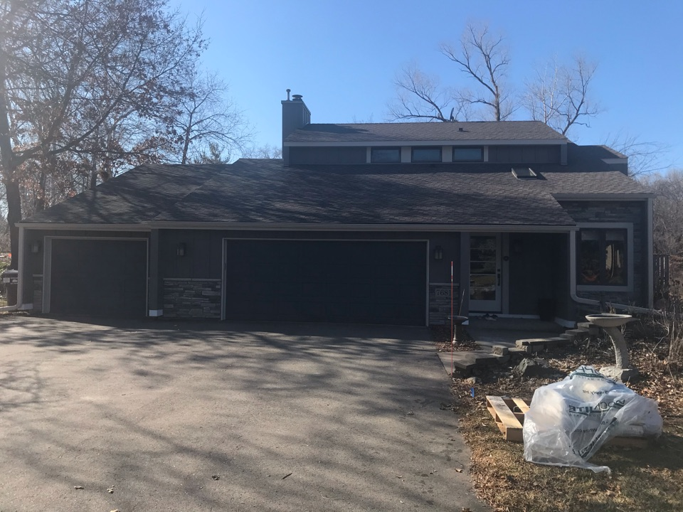 Inver Grove Heights, MN - Exterior remodel with James Hardie lap siding and James Hardie board and baton. Viral stone on front elevation. Aluminum soffit and fascia.