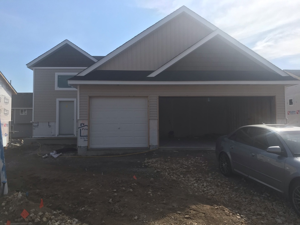 Shakopee, MN - New construction home with vinyl lap siding vinyl shakes and vinyl board and baton. Aluminum soffit and fascia.