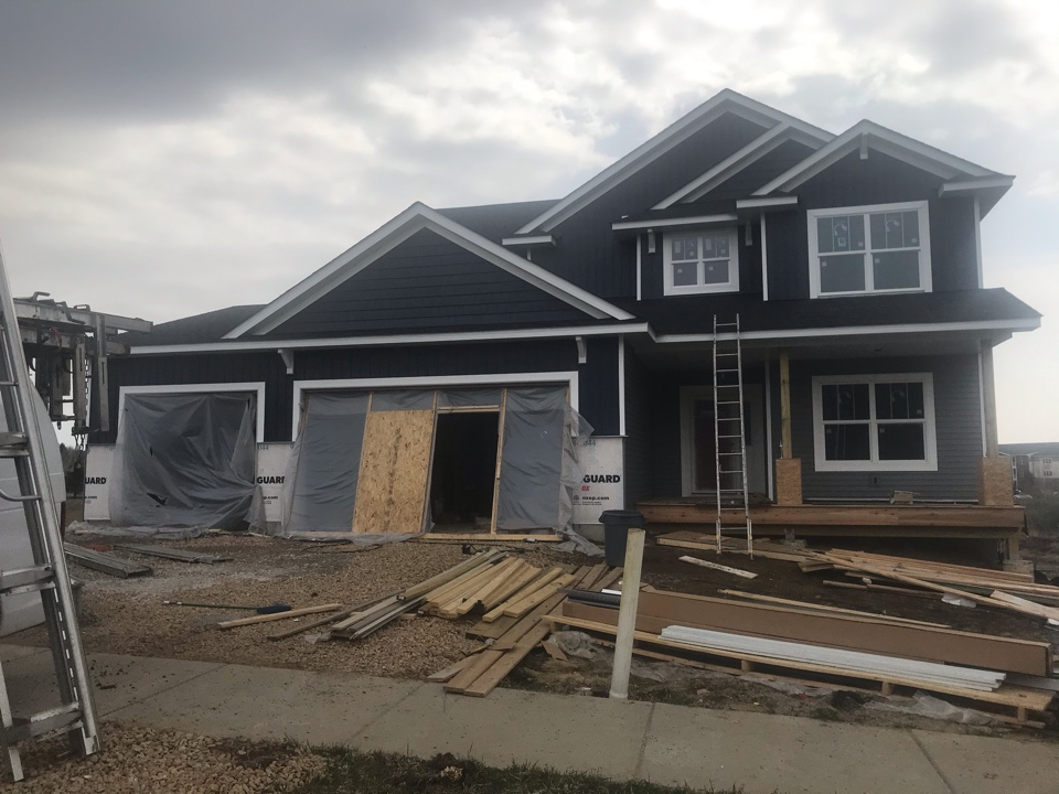 Lakeville, MN - New construction home with vinyl lap siding vinyl shakes and vinyl board and baton aluminum soffit and fascia