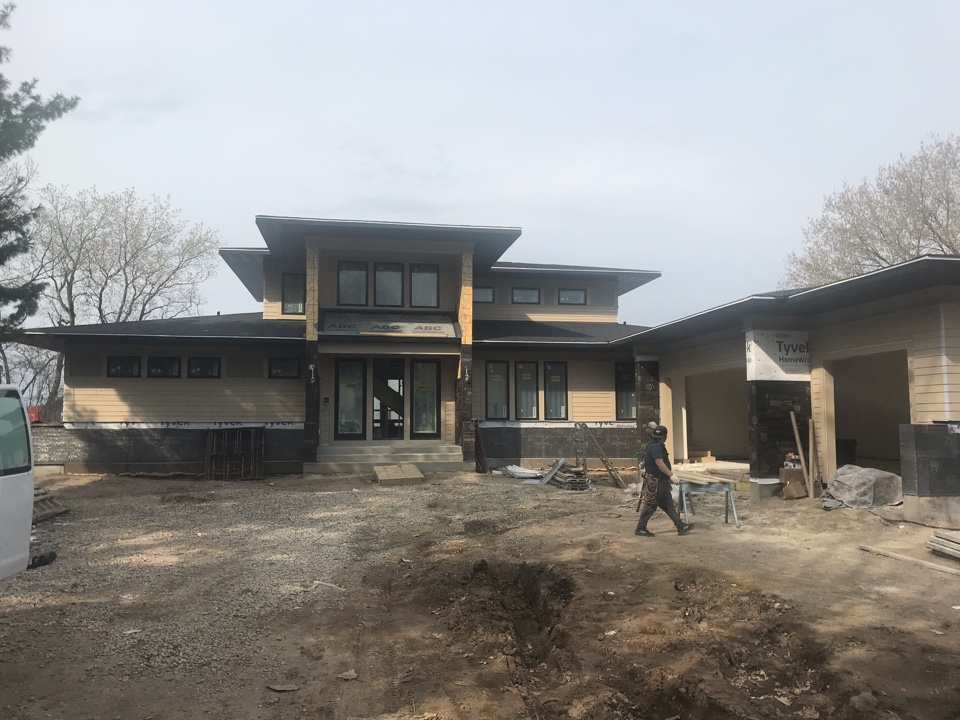Lakeville, MN - New construction home with LP Smartside lap siding. Aluminum soffit and fascia.
