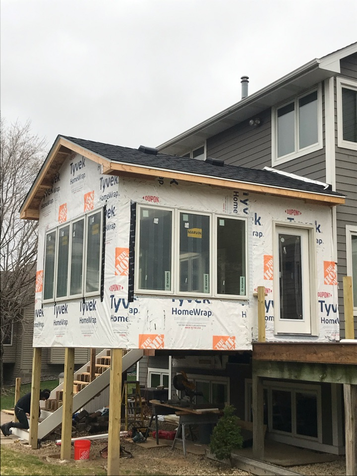 Minneapolis, MN - New porch addition on home. Krech Exteriors installed 4 square of Timberline HDZ architectural asphalt shingle in the color Weathered Wood. Also installed black flashing in W Valley and Step Tins. Installed White Drip Edge. Great looking new addition!