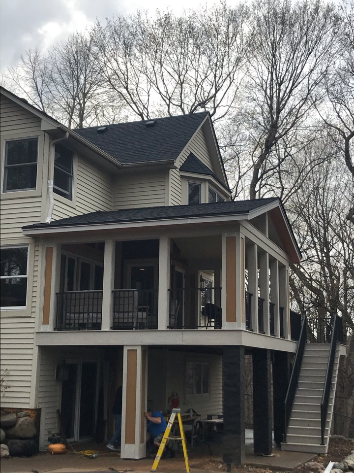 Shorewood, MN - New porch addition, newly installed GAF Timberline HDZ Asphalt shingle in the color Charcoal. Great looking new addition