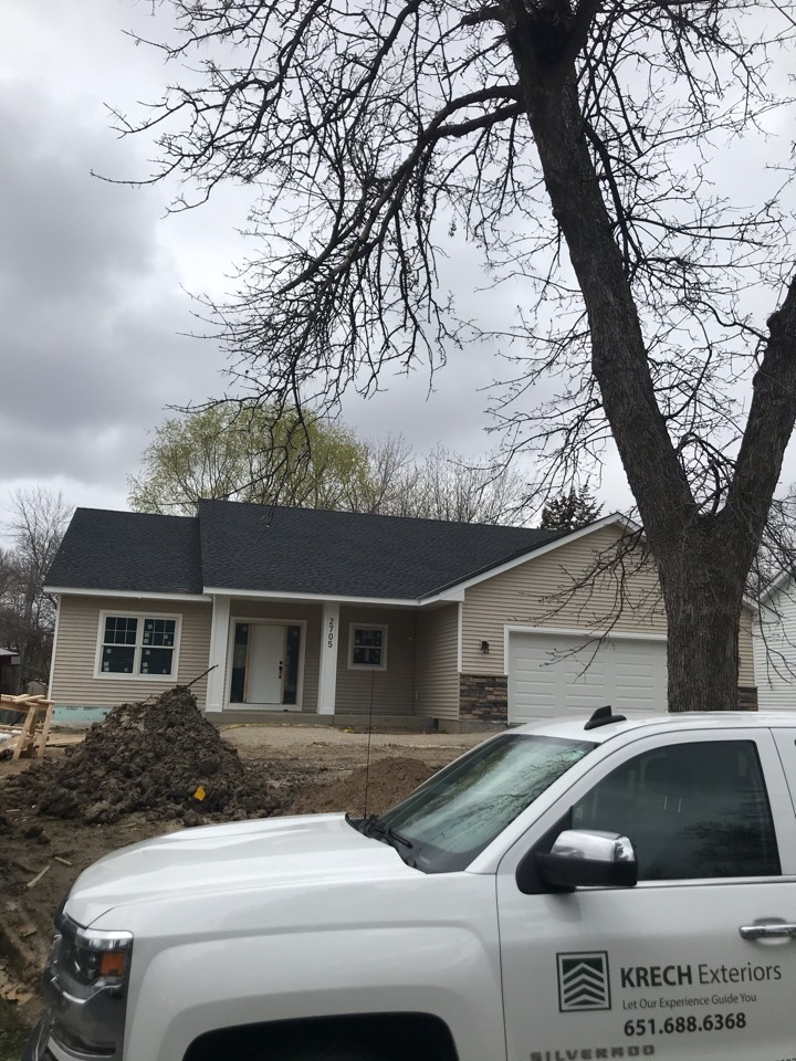 Minneapolis, MN - New construction siding: installed Royal Estate D/4 vinyl lap siding in the color sand in all elevations. Installed white vinyl lineal trim around all openings. Installed white aluminum soffit and facia all throughout. Installed prefinished smartside LP trim for front entry columns. Wrapped garage door jambs with white aluminum. Great looking new home!