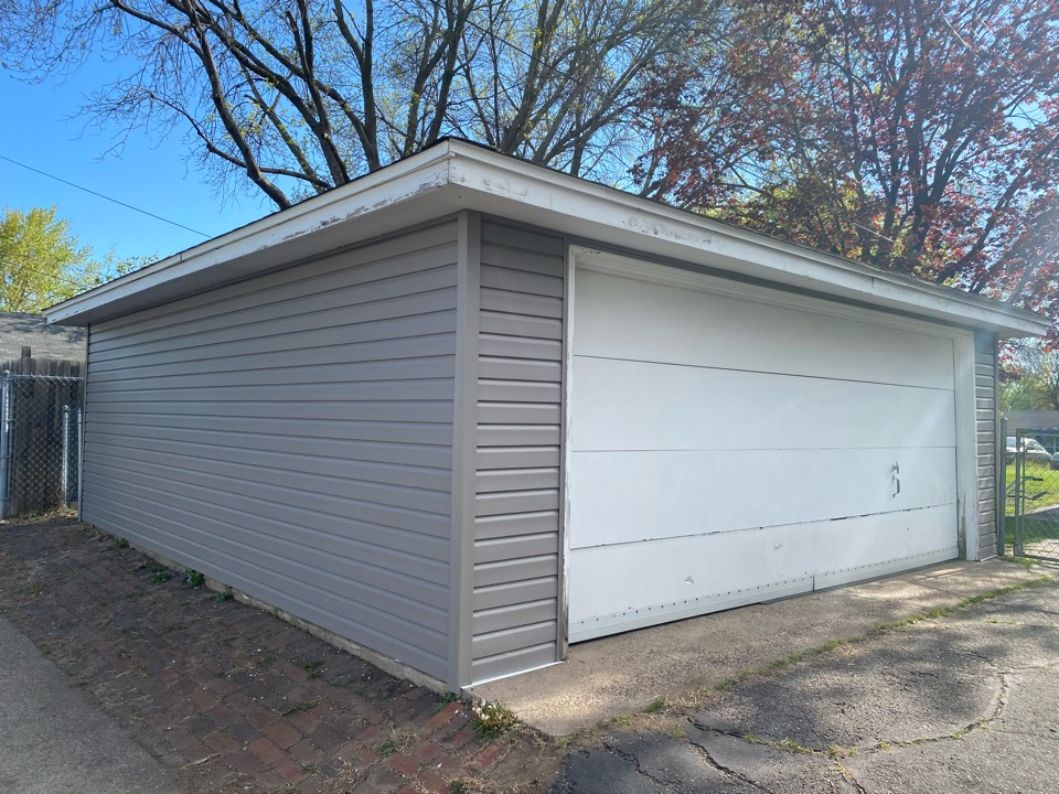 Minneapolis, MN - Krech Exteriors just finished this perfect vinyl reside. The Alside Dutch Lap siding turned out great in this Storm color.