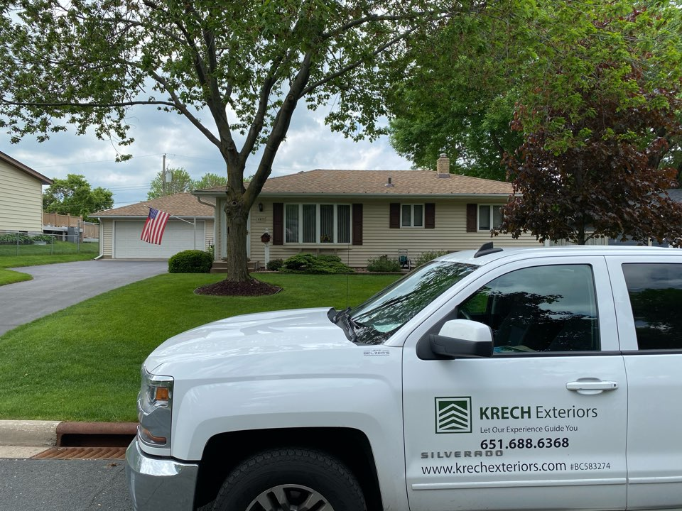 Inver Grove Heights, MN - Installed GAF Timberline HDZ Architectural Asphalt Shingle in the color Shake Wood. All roofing material including underlayment material such as Tar Paper and Ice & Water was installed per GAF regulations/specifications. All metal flashing material such as Roof Vents, Pipe Stacks, Dormers, and Step Tins were installed in the color Bronze to coincide with the color of the shingle. Great looking new roof!