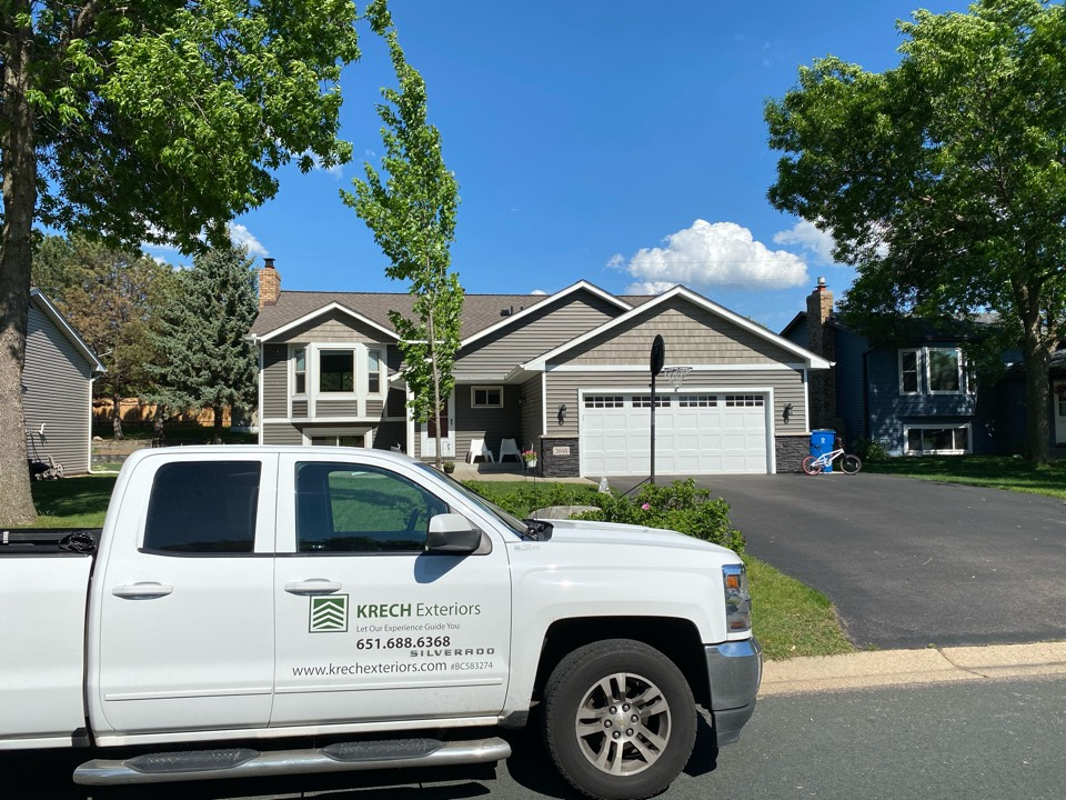 Eagan, MN - Installed GAF Timberline HDZ Architectural Asphalt Shingle in the color Mission Brown. All roofing material including underlayment material such as Tar Paper and Ice & Water was installed per GAF regulations/specifications. All metal flashing material such as Roof Vents, W Valleys, Pipe Stacks, Dormers, and Step Tins were installed in the color Bronze to coincide with the color of the shingle. Great looking new roof!
