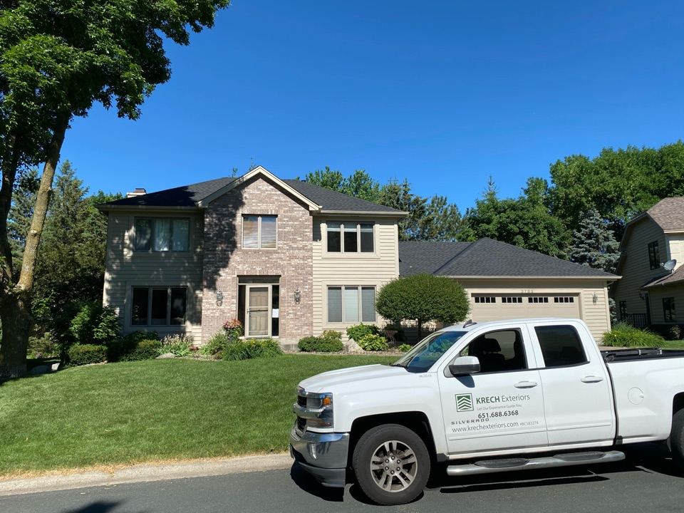 Eagan, MN - Installed GAF Timberline HDZ Architectural Asphalt Shingle in the color Charcoal. All roofing material including underlayment material such as Tar Paper and Ice & Water was installed per GAF regulations/specifications. All metal flashing material such as Roof Vents, W Valleys, Pipe Stacks, Dormers, and Step Tins were installed in the color Black to coincide with the color of the shingle. Great looking new roof!