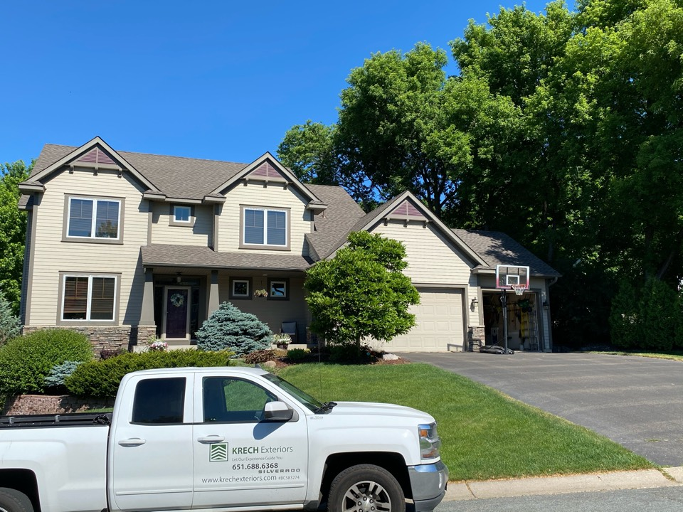 Eagan, MN - Installed GAF Timberline HDZ Architectural Asphalt Shingle in the color Mission Brown. All roofing material including underlayment material such as Tar Paper and Ice & Water was installed per GAF regulations/specifications. All metal flashing material such as Roof Vents, Pipe Stacks, Dormers, and Step Tins were installed in the color Bronze to coincide with the color of the shingle. Great looking new roof!
